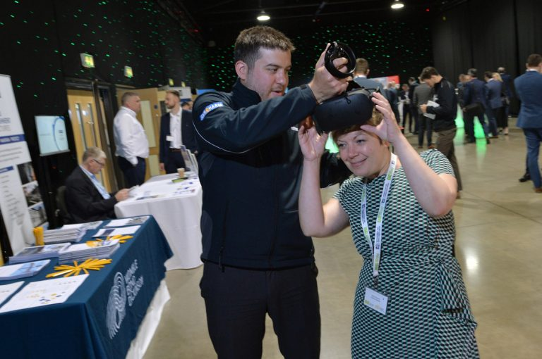 Attendees-try-out-a-VR-Headset-at-West-Yorkshire-Development-Conference