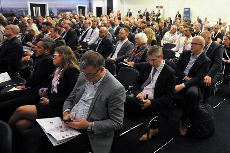 Attendees-take-notes-on-their-phones-Greater-Manchester-Development-Conference-2019