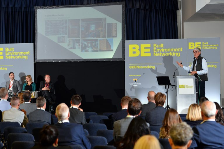 Guy-Dixon-stands-to-present-at-Greater-Manchester-Development-Conference-2019