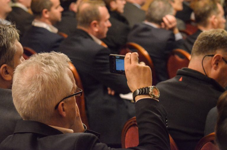 Attendee takes a photo of the speakers at Liverpool Development Plans 2018