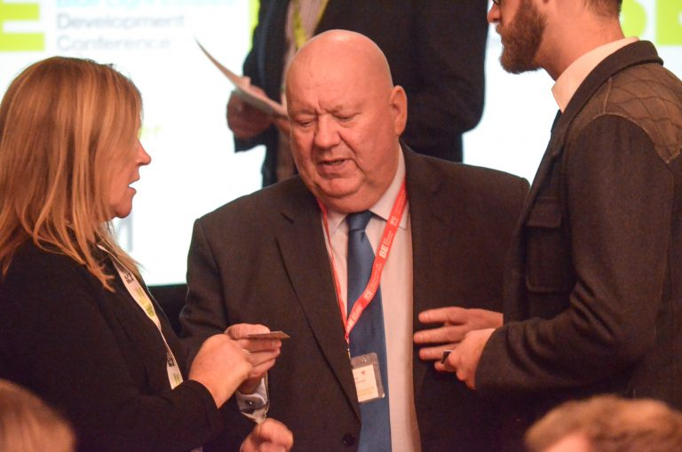 Joe Anderson hands out a business card at Liverpool Development Plans 2018