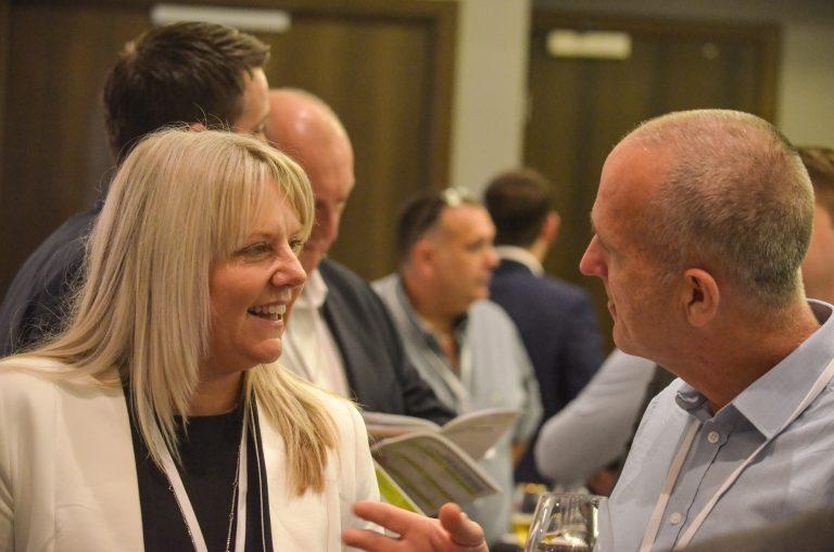 Michelle McKechnie Talks with an attendee