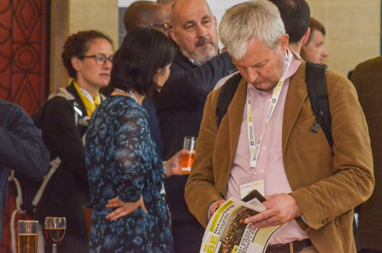 Bristol Development Plans 2019 Attendee checks the magazine for upcoming events