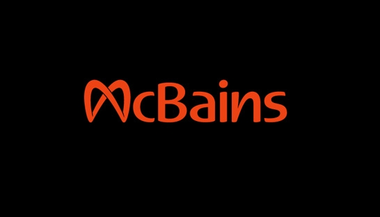 Logo Partner McBains Construction Bidding Blue Light