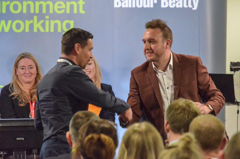 Matt Christie Hands the Champagne to its winner