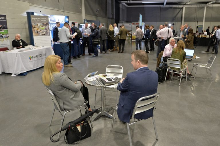 2 attendee's sit and discuss the day over a cup of coffee Manufacturing Conference & Exhibition 2019