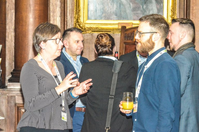 Attendee's discuss the day of networking at North West Universities Development Plans