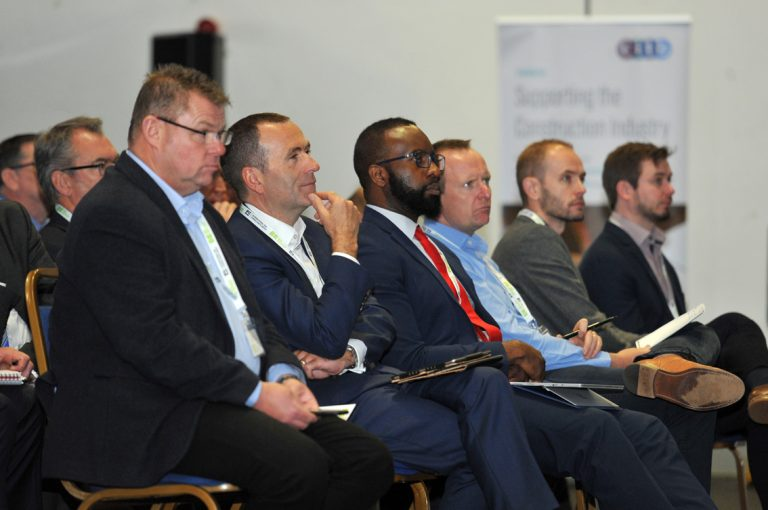 The front row watches the speakers present at Airport Cities Development Conference 2019