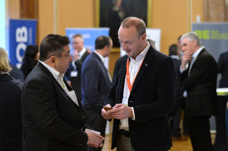 Simon Toplass speaks to an attendee and trades contact details North West Development Confernce, Liverpool.10.12.19