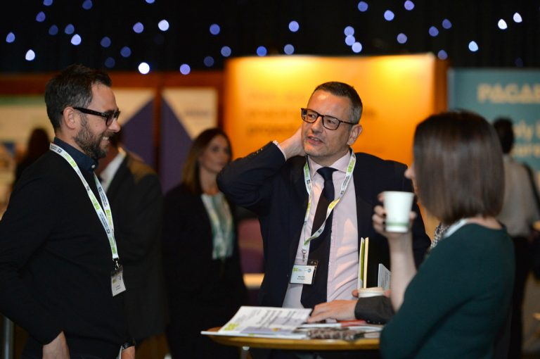 Attendee's discuss business at the Conference