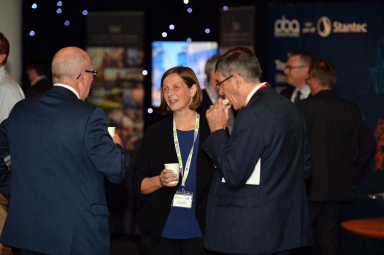Networking in the main hall at the EICC