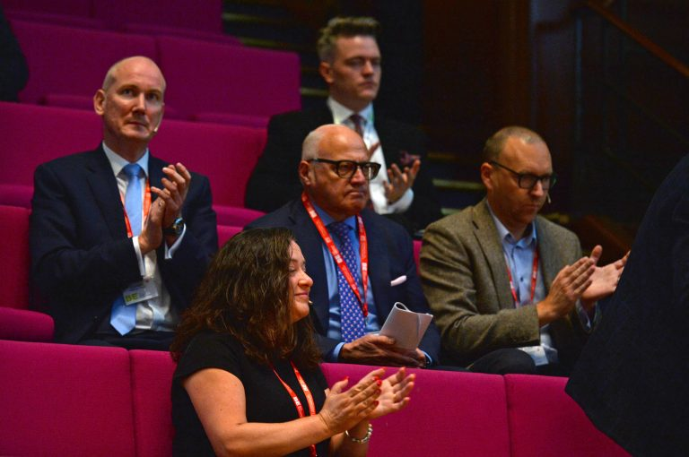 Speakers watch on as their colleagues take the floor London Property Club 2019